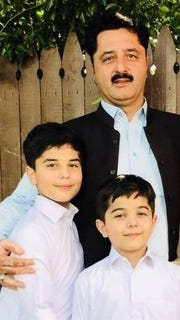 Shakeel Khan with his sons, 12-year-old Hassan and 8-year-old Temur.