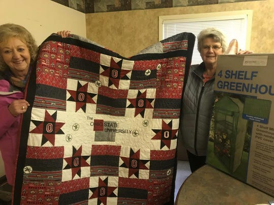 As the countdown to Rotary Auctionfest 2019 continues, Marylyn Strang (left) and Virginia Hammontree (right) hold an exceptional Ohio State-themed quilt. The team receives, sorts and numbers donations for the April 13 auction at Trillium Event Center.
