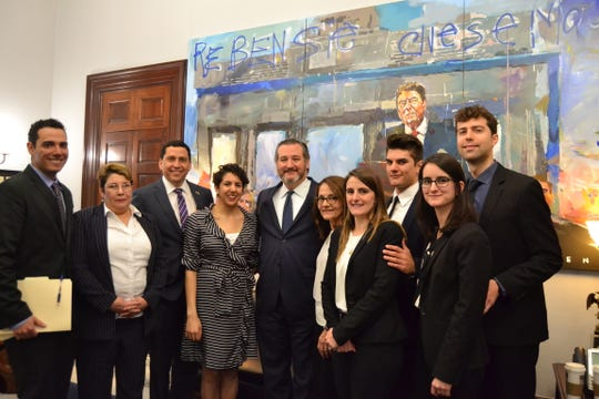 U.S. Sen. Ted Cruz, center, meets with relatives of the 'Citgo Six,' who are representatives of Citgo being held in Venezuela on April 2, 2019.