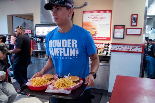 J.D. Garcia picks up his order from the counter at Freddy's Frozen Custard & Steakburgers, which opened on Tuesday, April 2, 2019. The Kansas-based restaurant offers burgers, hot dogs, custard and sandwiches.
