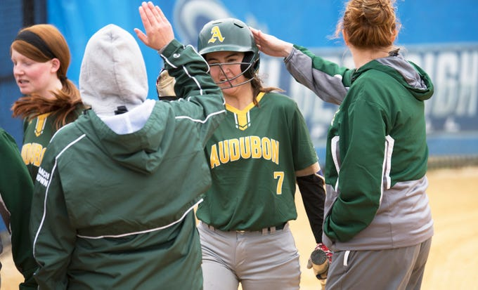 Audubon's Morgan Hearn is congratulated by Audubon coaches and players after Hearn hit a solo home run during the second inning of Tuesday's softball game between Audubon and Sterling, played at Sterling High School.  Audubon beat Sterling, 9-3.