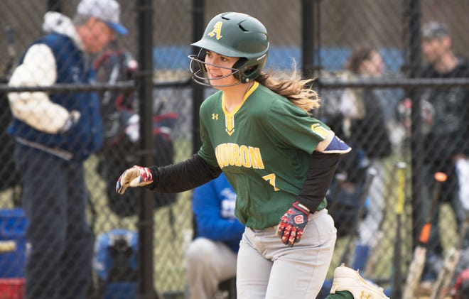 Audubon's Morgan Hearn smiles as she heads home after hitting a solo home run during the second inning of Tuesday's softball game between Audubon and Sterling, played at Sterling High School.  Audubon beat Sterling, 9-3.