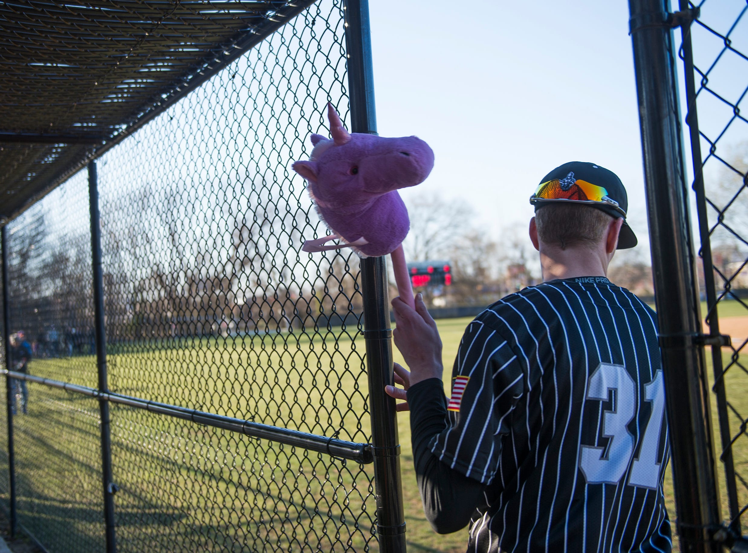 Bishop Eustace's Matt Bravyak (31) grabs the team's unicorn following an Opening Day win against Eastern Monday, April 1, 2019 in Pennsauken. Eustace won 12-0.