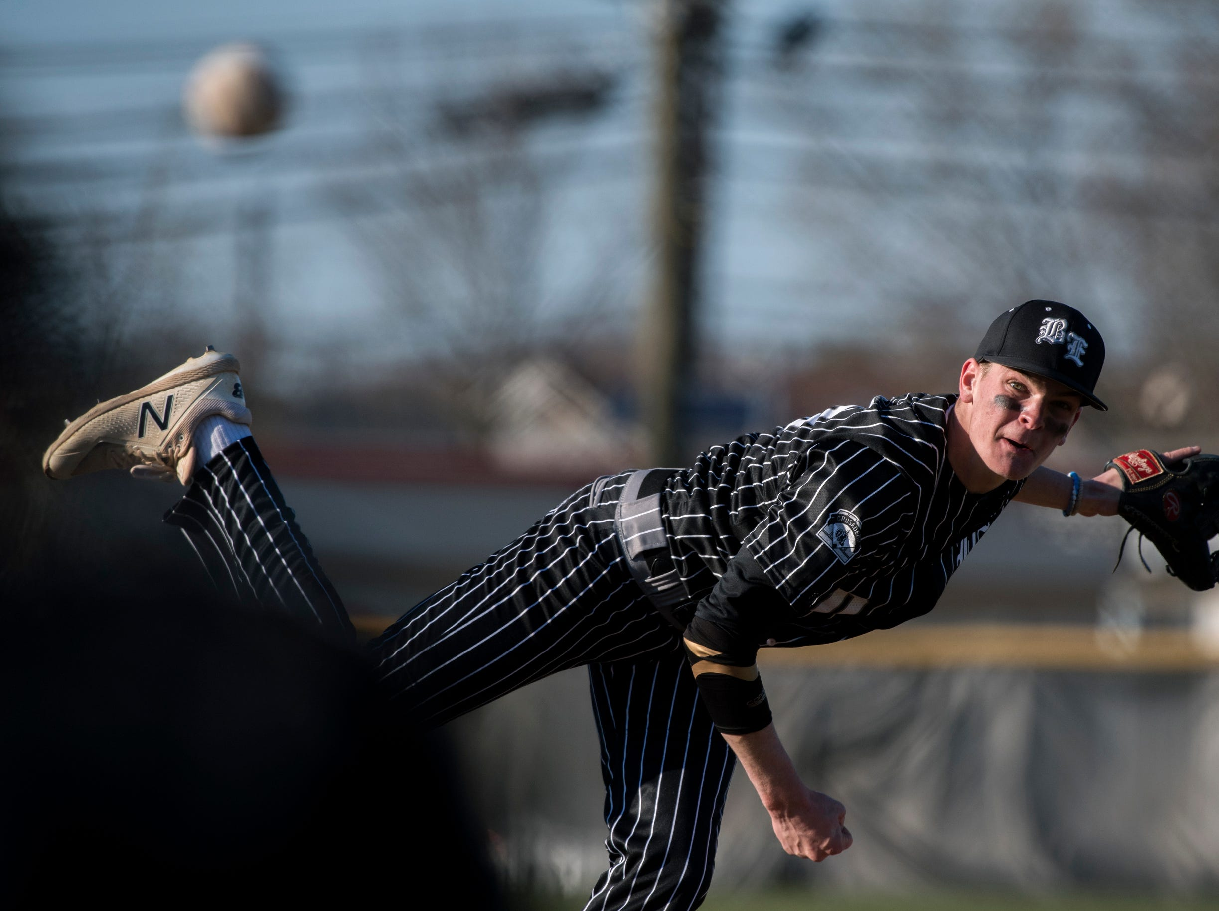 Bishop Eustace's Chuck Sanzio (20) delivers a pitch against Eastern Monday, April 1, 2019 in Pennsauken. Eustace won 12-0.
