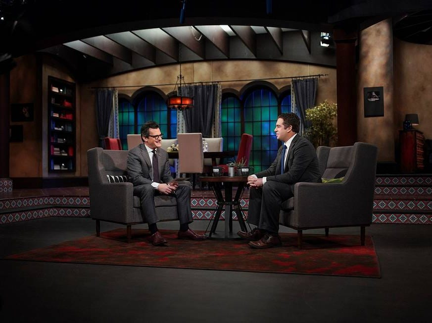 Turner Classic Movies host Ben Mankiewicz (left) chats with Jonathan Chapman of Cherry Hill for an on-air movie dedication at TCM's Atlanta headquarters. Chapman will appear on the cable network April 26 to dedicate the film 'High Society' to his wife, Alex.