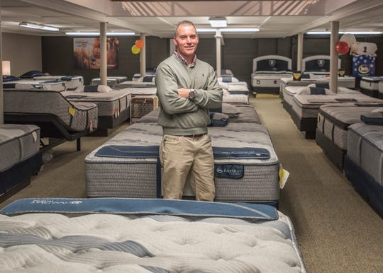 Seth Brown, who is the fifth generation of the Brown family to be involved with Globe Furniture, shows off their new, larger downstairs space called Globe Mattress First, which is dedicated to beds and other products. Brown is proud that when local customers come into the store they know who they are buying from and that their ethics and values concerning customer service have remained the same over the generations.