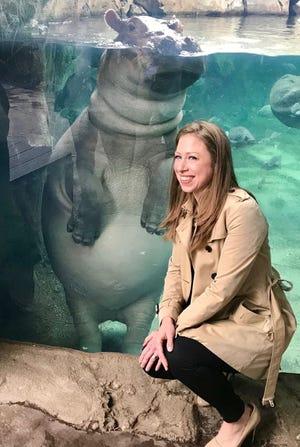 Chelsea Clinton meets Fiona the hippo at Cincinnati Zoo and Botanical Gardens.