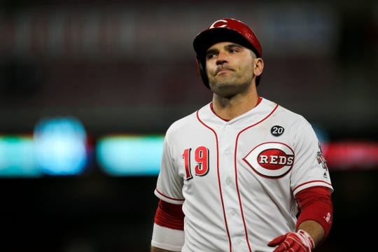 Cincinnati Reds first baseman Joey Votto (19) returns to the dugout after flying out in the ninth inning of the MLB National League game between the Cincinnati Reds and the Milwaukee Brewers at Great American Ball Park in downtown Cincinnati on Monday, April 1, 2019. The Reds fell 4-3 in the series opener.