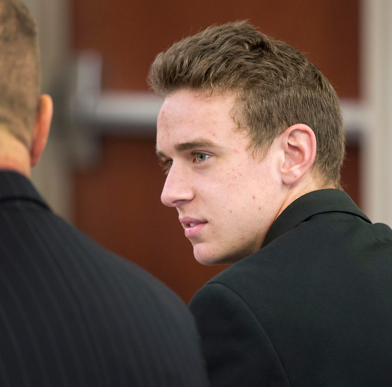 Video Image: Jerome Kunkel, 18, confers with his attorney, Thomas Burns, during his hearing in Boone County Circuit Court Monday, April 1, 2019. Jerome, a senior at Assumption Academy in Walton objected to the demand of public health officials for vaccinations against chickenpox when 32 students at his small Catholic school came down with the illness this year.