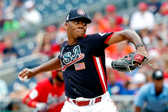 USA pitcher Hunter Greene (3) pitches in the third inning against the World Team during the 2018 All Star Futures Game at Nationals Ballpark.