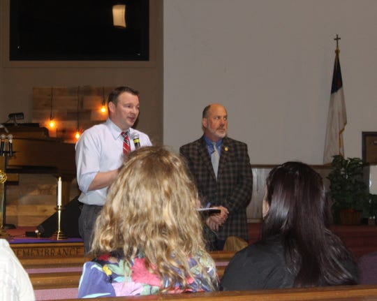 Montgomery County Public Health Director Joey Smith and Tennessee Suicide Prevention Network Executive Director Scott Ridgway speak to people from the New Providence Middle School community at a suicide prevention meeting March 21, 2019.