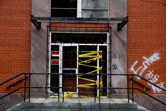 Police tape and signs advising passersby to keep out are posted at an entrance to the old building at Frosty Morn in Clarksville, Tenn., on Friday, March 29, 2019.