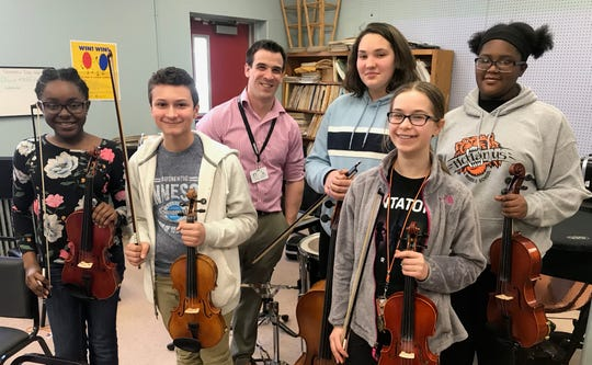 McManus: McManus Middle School in Linden students who were selected for the Central Jersey Music Educators Association seventh- and eighth-grade honors orchestra. (From left)Jaina McKoy, violin; Joshua Vega, violin; orchestra teacher Johnathan Birckhead; Olivia Muniz, cello; Veronica Belzak, violin; and Nneoma Oseagulu, viola.