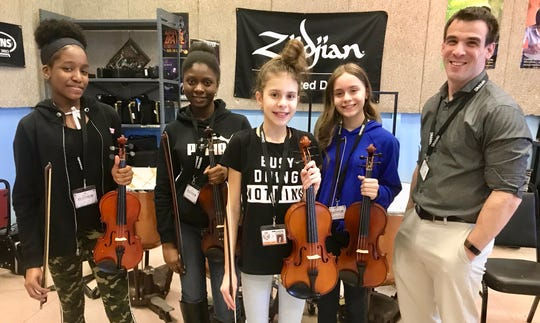 Soehl Middle School students who were selected for the Central Jersey Music Educators Association seventh- and eighth-grade honors orchestra. (From left) Jessica Uzor, violin; Medjina Sillion, violin; Viktoria Madarova, viola; Kayla Lima, violin; and orchestra teacher Johnathan Birckhead.