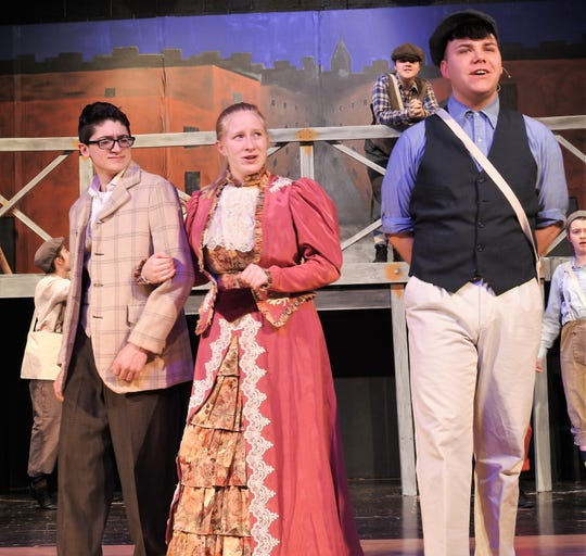 "Daniel Scott, Hope Asbury and Harrison Orand in a scene from ""Newsies"" playing this weekend at Ridgewood High School. The play is loosely based on the 1899 newsboy strike in New York City."