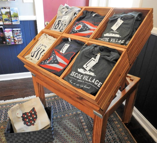 T-shirts from Rusty Plow Press and other items for local businesses can be found in the Coshocton Supply Company, operated by the Coshocton Visitors Bureau in Roscoe Village.