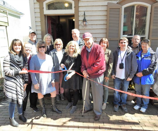 Mindy Brems cut the ribbon for the grand opening of the Coshocton Supply Company with local dignitaries, store vendors and representatives of the Coshocton Visitors Bureau. The store, which opened earlier this year, sells items designed or made in Coshocton County.