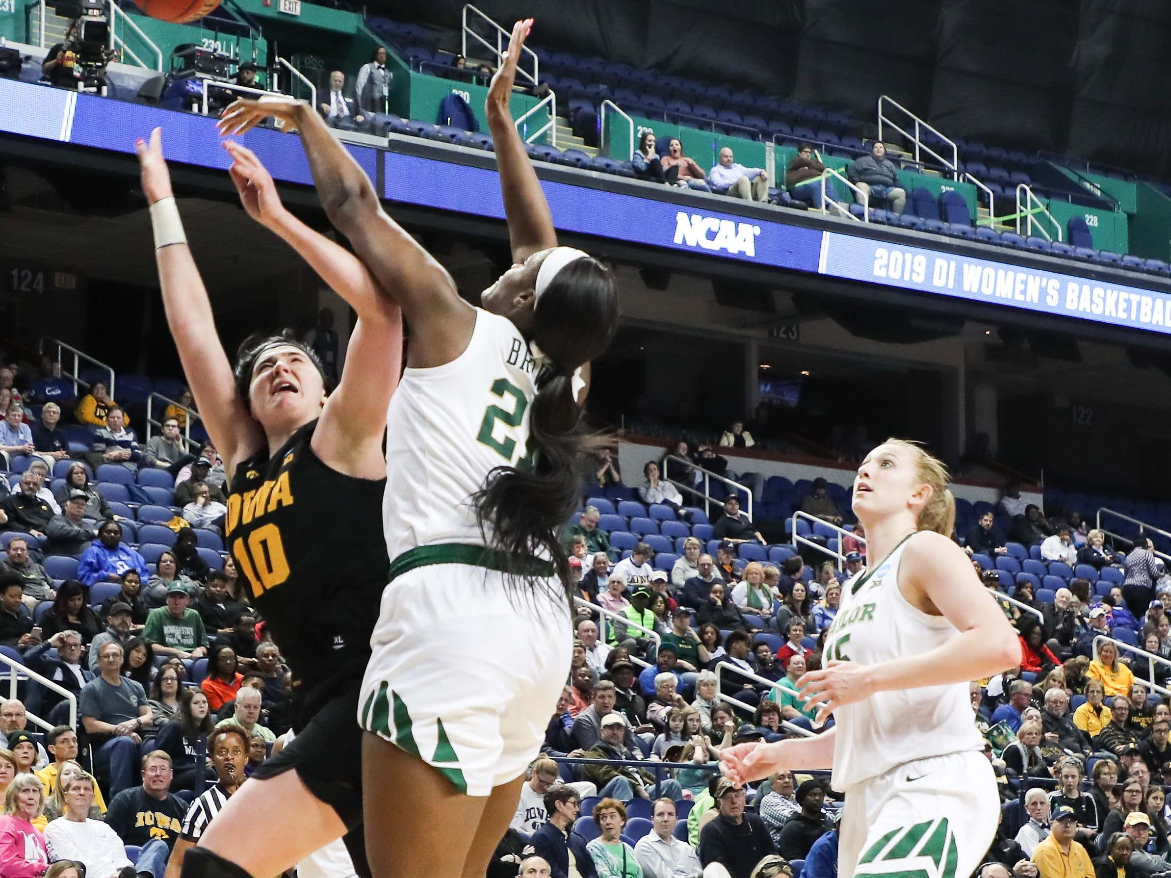 Baylor Lady Bears center Kalani Brown (21) blocks a shot by Iowa Hawkeyes forward Megan Gustafson (10) during the second half in the championship game of the Greensboro regional in the women's 2019 NCAA Tournament at the Greensboro Coliseum.