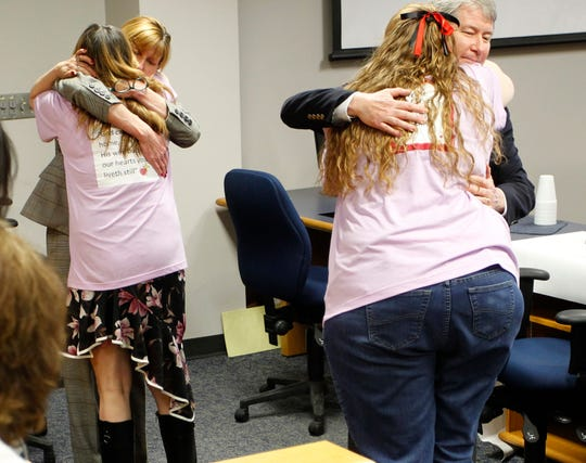 Prosecutors Julie Walton and Mike Walton receive hugs from Sheri McCormick and Mary Maxwell-Rockwell after the verdict finding Stanley Carter Liggins guilty in McCormick's daughter Jennifer Lewis' death on Tuesday, April 2, 2019. in Waterloo, Iowa. In his fourth trial, a jury found Liggins guilty in the 1990 killing of the 9-year-old girl whose body was found in Davenport.