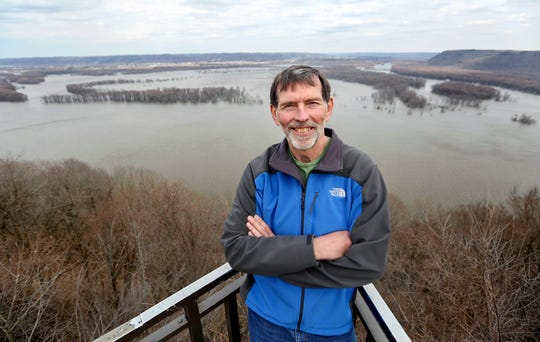 Don Smalley, of Marquette, Iowa, who is trying to accomplish a goal of reaching the highest point in all 50 states, poses Monday, April 1, 2019, at Pikes Peak State Park in McGregor, Iowa.