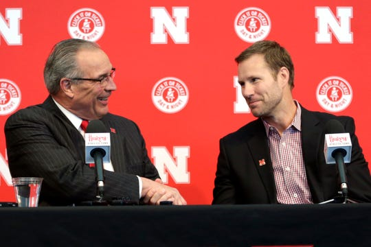 Nebraska Athletic Director Bill Moos, left, greets Fred Hoiberg as he is introduced as Nebraska's new NCAA college basketball head coach at a news conference in Lincoln, Neb., Tuesday, April 2, 2019. Hoiberg, former head coach for the Chicago Bulls and Iowa State, replaces fired head coach Tim Miles.