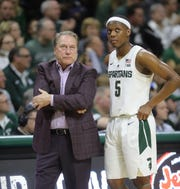 Michigan State head coach Tom Izzo talks with Cassius Winston during second half action against Green Bay  Sunday, December 16, 2018, in East Lansing.