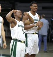 Michigan State guard Cassius Winston and Xavier Tillman have a little fun during picture day on Thursday, October 25, 2018, in East Lansing.