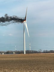 A fire burns at a wind turbine on Monday, April 1, 2019, near Elkton, Mich. The fire drew spectators who watched flaming debris fall to the ground, but no injuries were reported. Crews let the fire burn itself out.