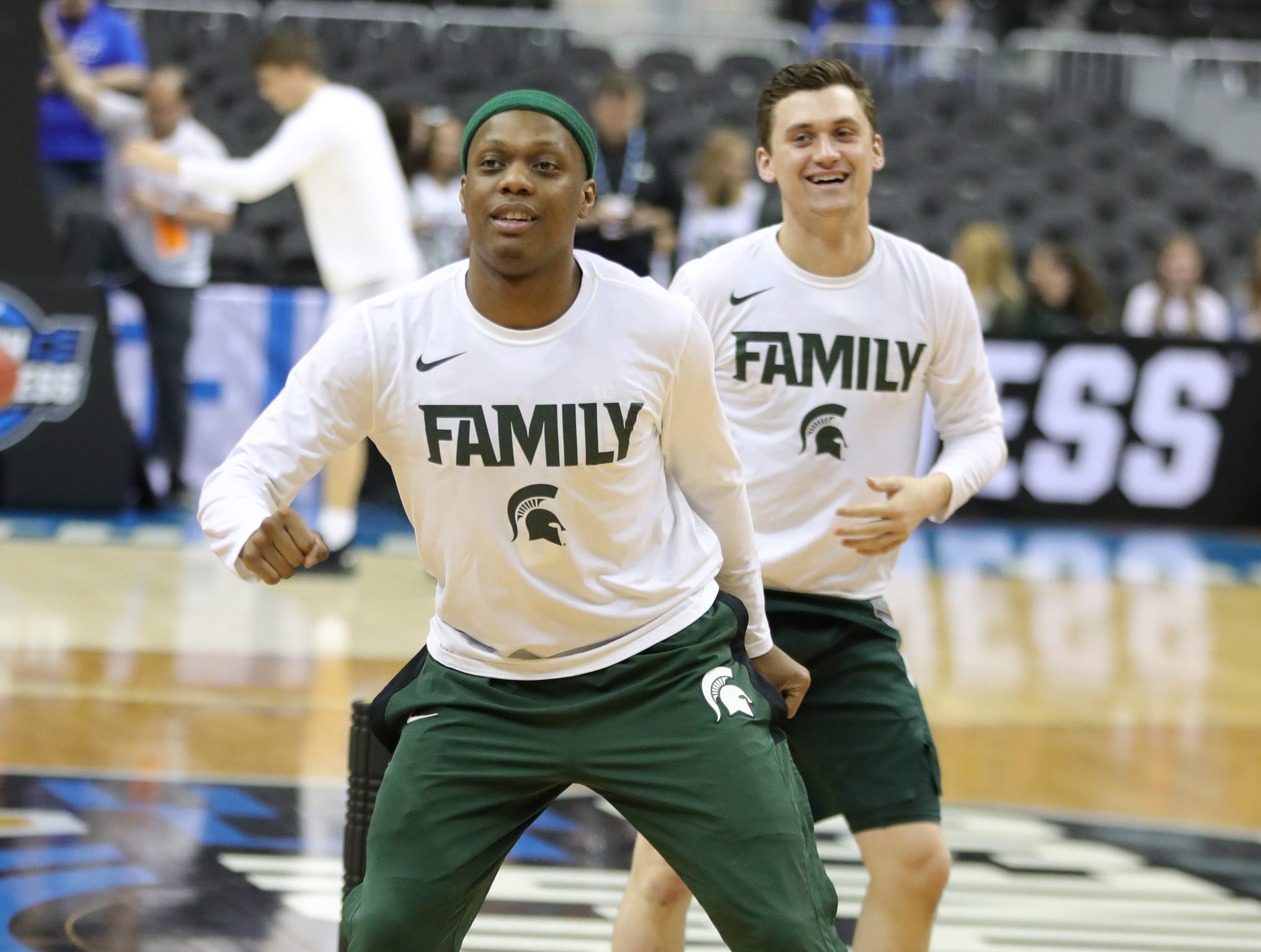 MSU guards Cassius Winston and Foster Loyer stretch before NCAA Regional Final action against  Duke Sunday, March 31, 2019, in Washington.