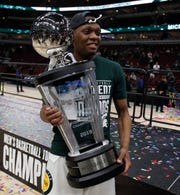 Michigan State guard Cassius Winston with the Big Ten tournament championship trophy after defeating Michigan 65-60 on Sunday, March 17, 2019 at the United Center in Chicago.