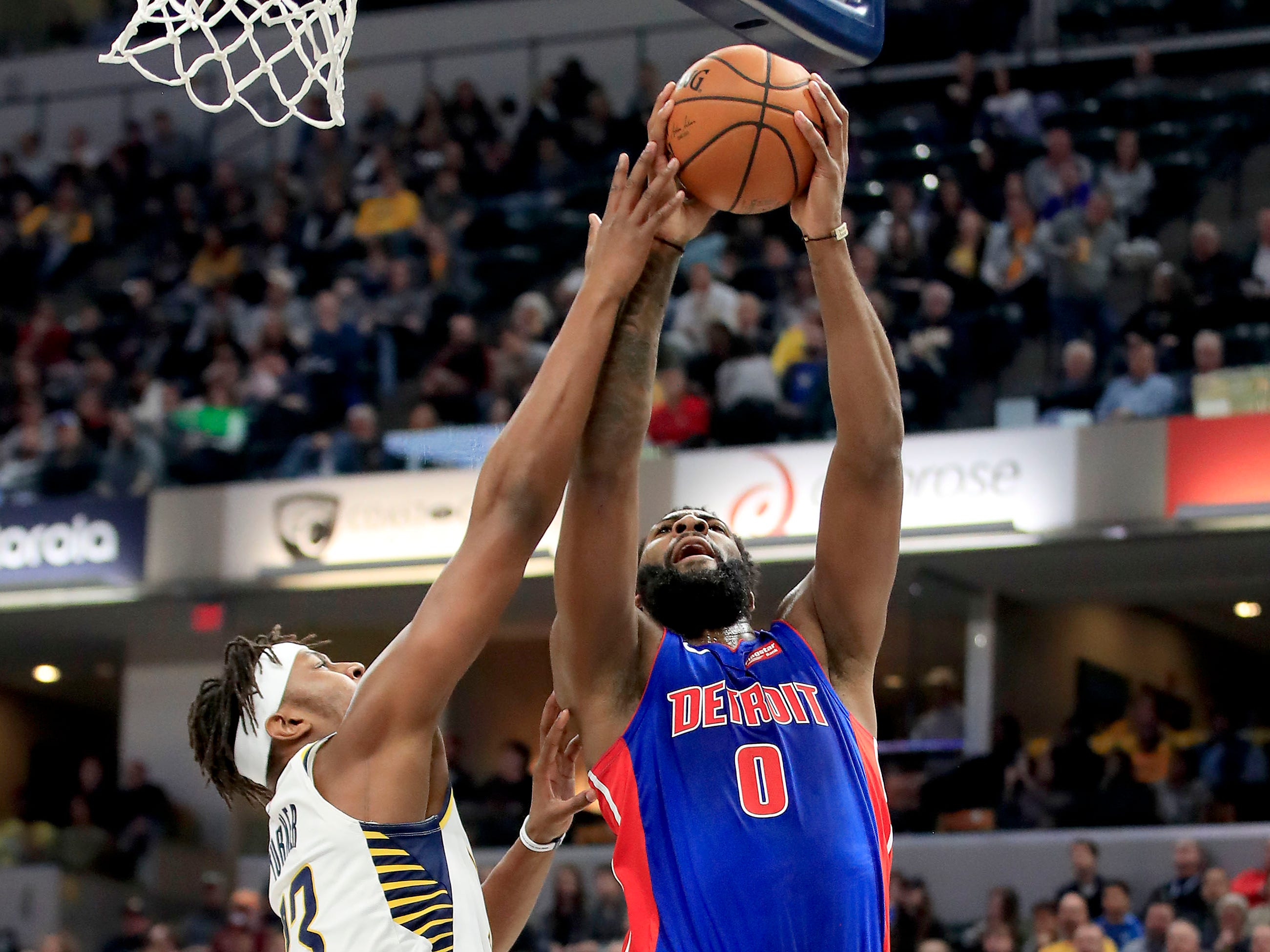 Detroit Pistons' Andre Drummond shoots against the Indiana Pacers' Myles Turner at Bankers Life Fieldhouse on April 1, 2019 in Indianapolis.