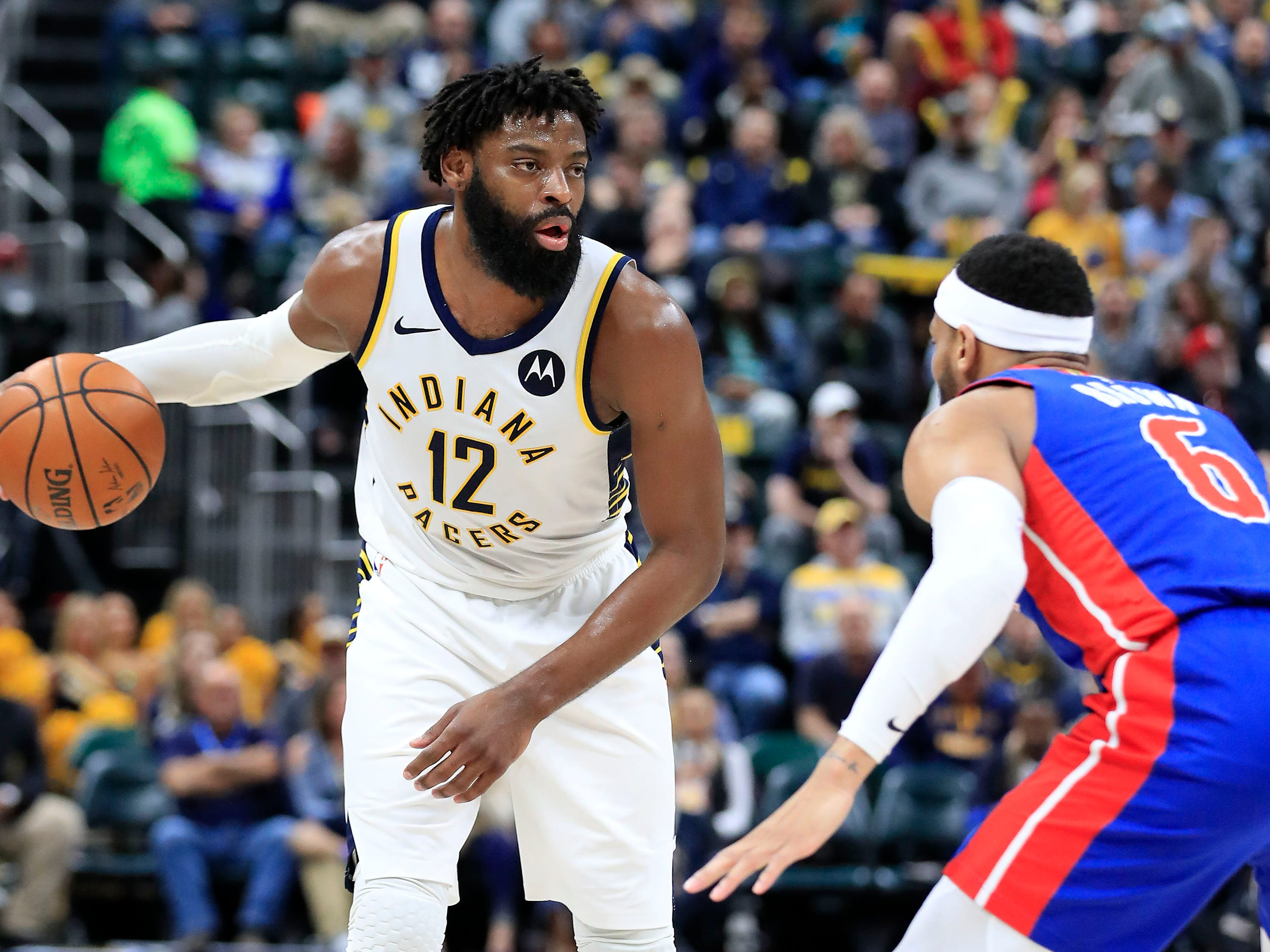 Indiana Pacers' Tyreke Evans dribbles against the Detroit Pistons' Bruce Brown at Bankers Life Fieldhouse on April 1, 2019 in Indianapolis.