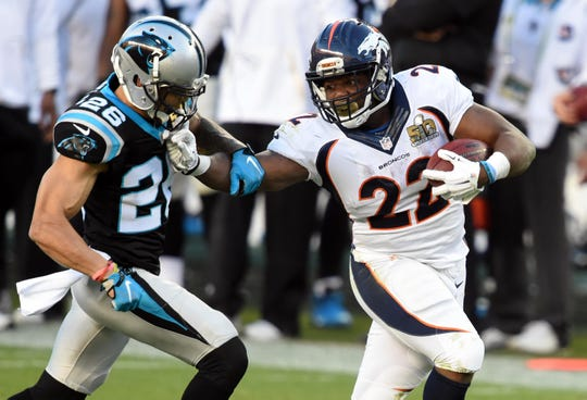 Denver Broncos running back C.J. Anderson runs against Carolina Panthers defensive back Cortland Finnegan in the second quarter in Super Bowl 50 at Levi's Stadium in Santa Clara, Calif., Feb. 7, 2016.