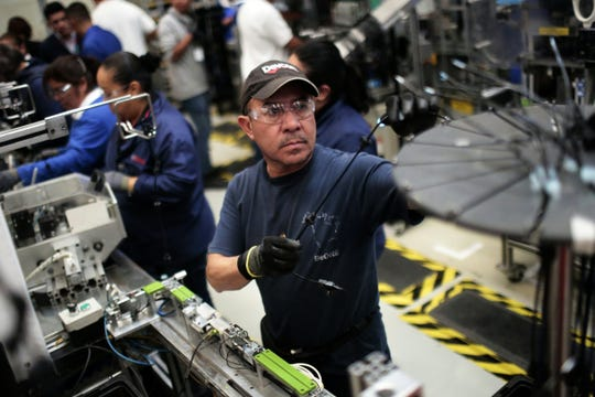 At work in the auto parts production line in the Bosch factory in San Luis Potosi, Mexico, on Jan. 11, 2017.