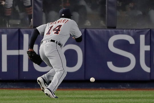 Tigers left fielder Christin Stewart chases the ball after committing a fielding error against the Yankees during the third inning Monday.