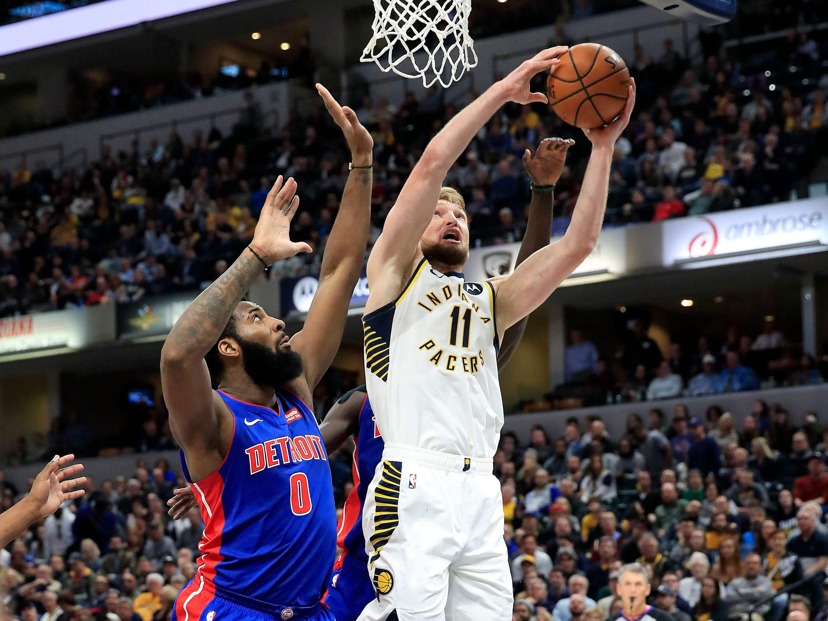 Indiana Pacers' Domantas Sabonis shoots against the Detroit Pistons' Andre Drummond at Bankers Life Fieldhouse on April 1, 2019 in Indianapolis.