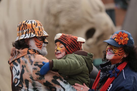 Tony Rinna of Southgate holds his grandson Mikah Bugeja of Southgate while waiting in line with his wife Pam Rinna for Bugeja's first Opening Day at Comerica Park in 2018.