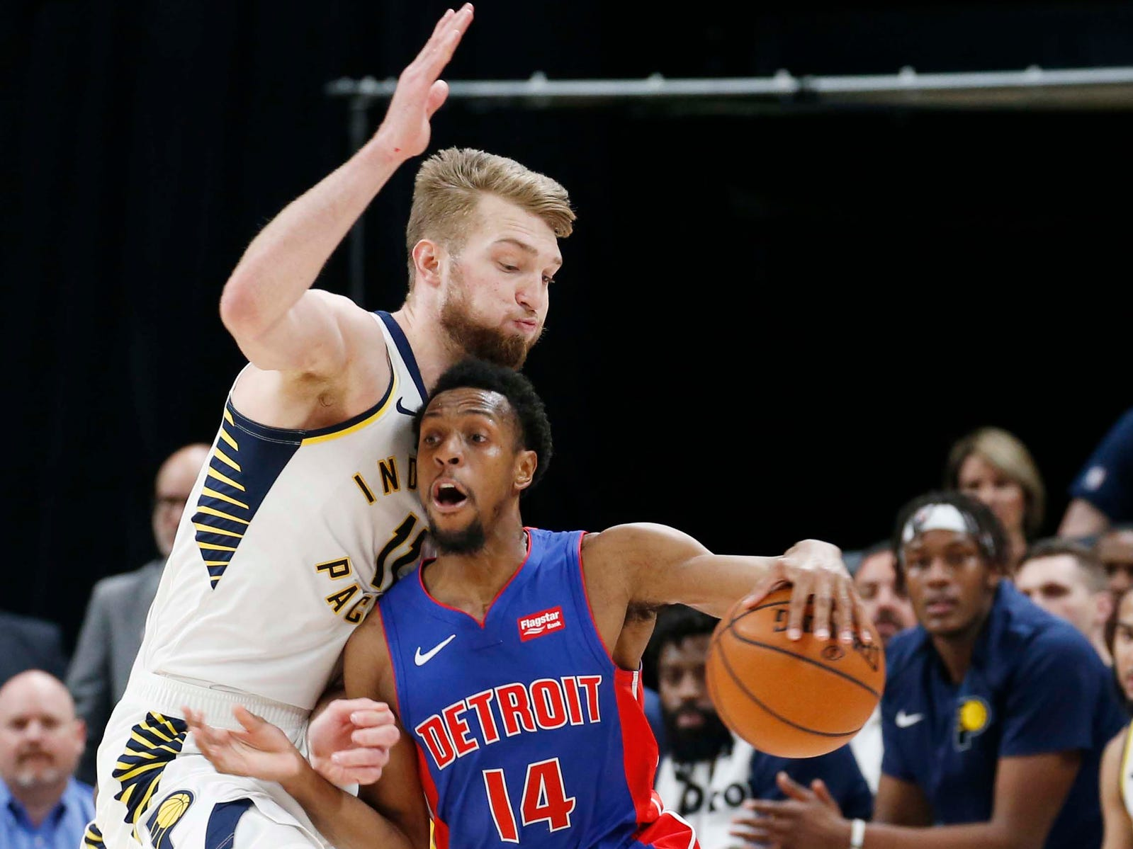 Detroit Pistons guard Ish Smith is guarded by Indiana Pacers forward Domantas Sabonis during the fourth quarter at Bankers Life Fieldhouse, April 1, 2019.