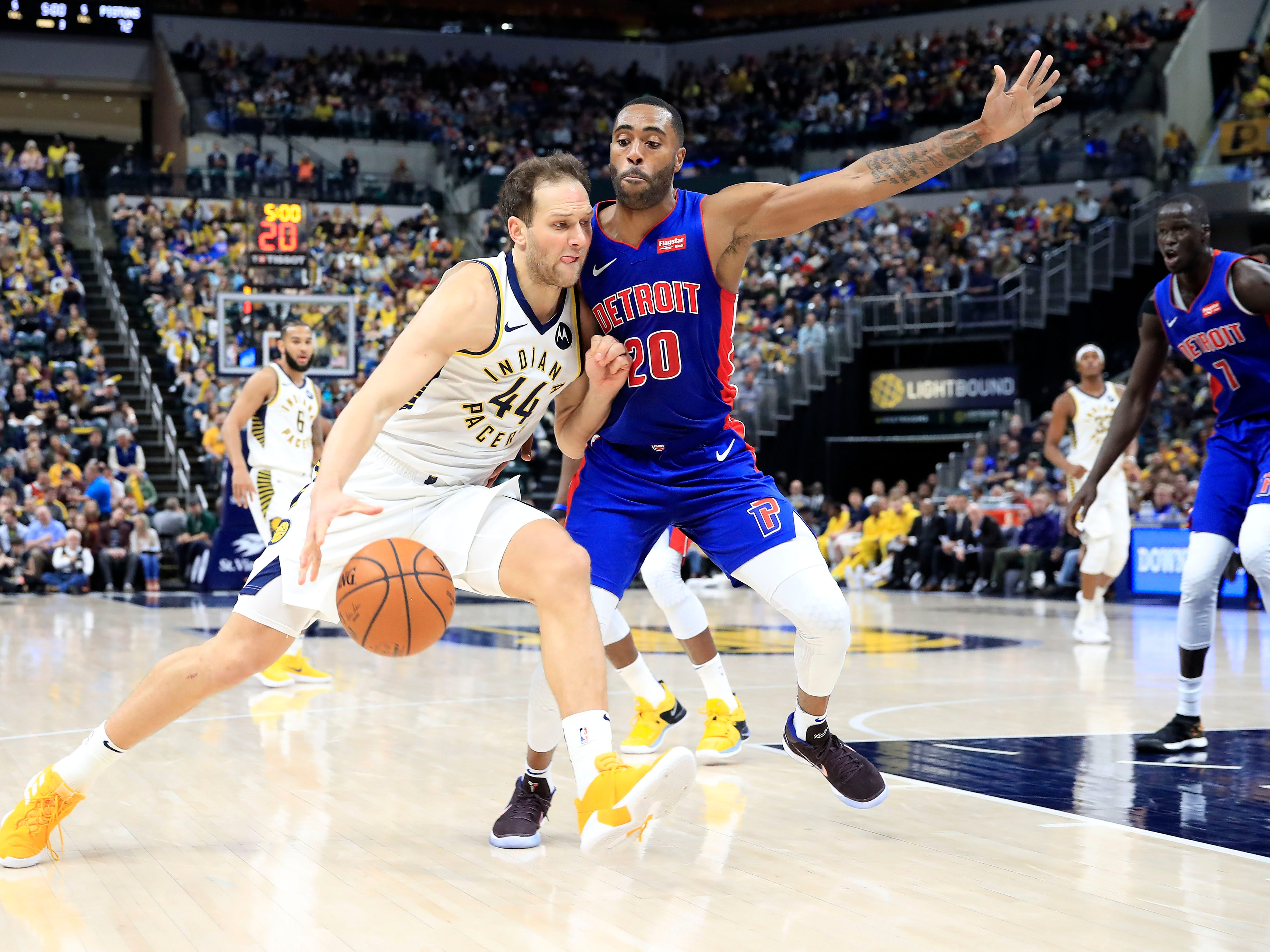 Indiana Pacers' Bojan Bogdanovic dribbles against the Detroit Pistons' Wayne Ellington at Bankers Life Fieldhouse on April 1, 2019 in Indianapolis.