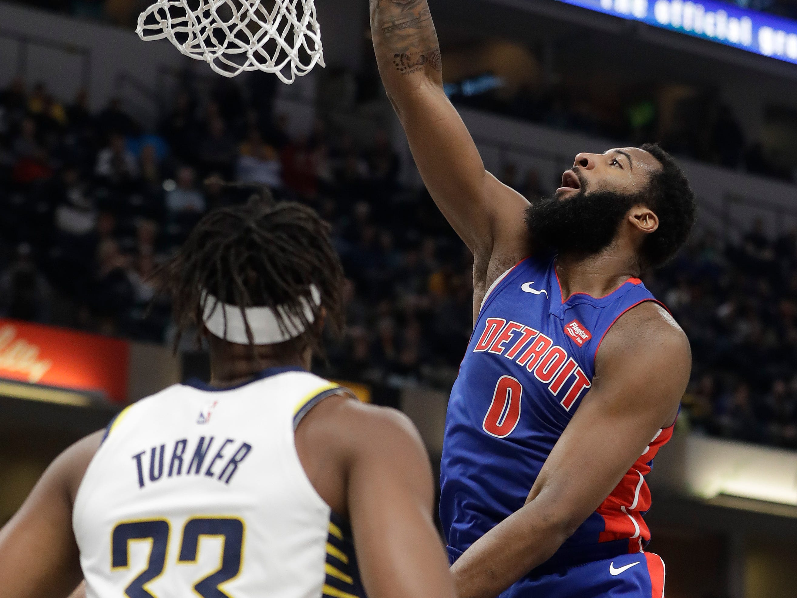 Detroit Pistons' Andre Drummond dunks against Indiana Pacers' Myles Turner during the first half Monday, April 1, 2019, in Indianapolis.