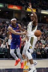 Detroit Pistons' Bruce Brown makes a pass against Indiana Pacers' Myles Turner during the first half Monday, April 1, 2019, in Indianapolis.