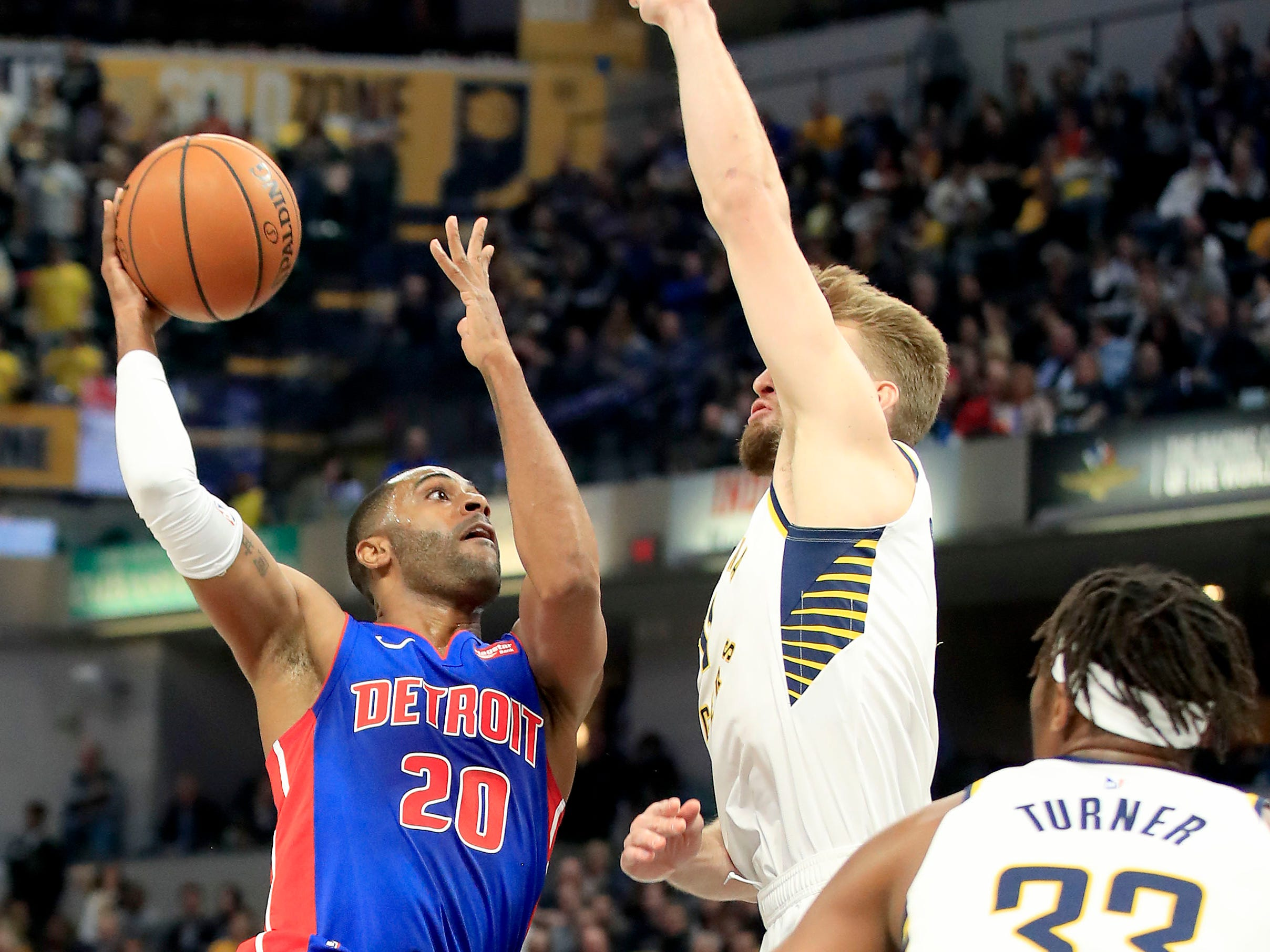 Detroit Pistons' Wayne Ellington shoots against Indiana Pacers' Domantas Sabonis at Bankers Life Fieldhouse on April 1, 2019 in Indianapolis.
