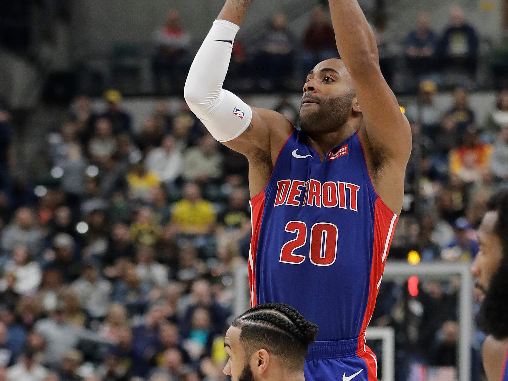Detroit Pistons' Wayne Ellington (20) puts up a shot against Indiana Pacers' Cory Joseph (6) during the first half.