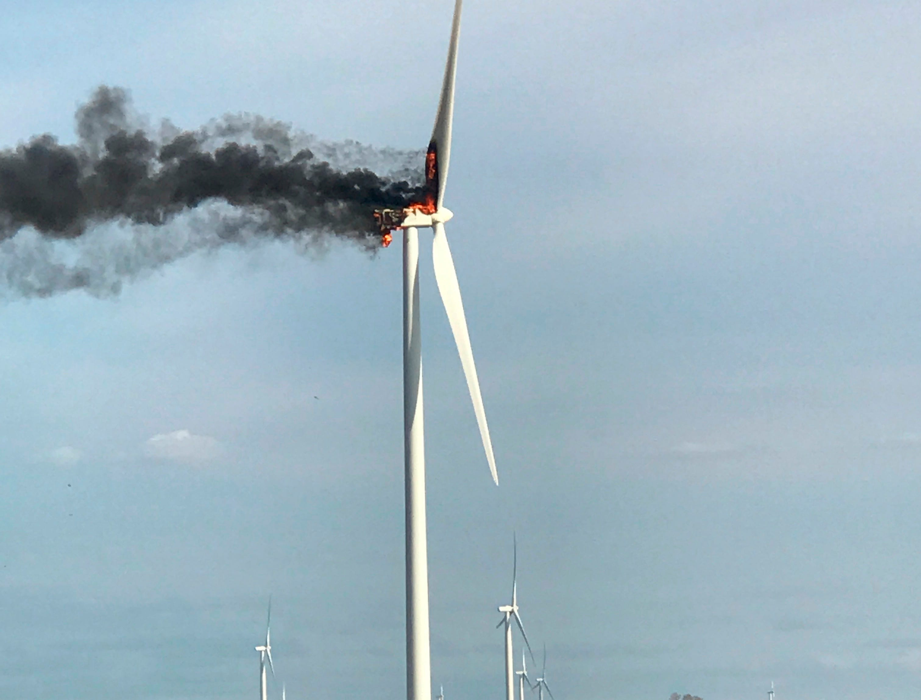 A fire burns at a wind turbine on Monday, April 1, 2019, near Elkton, Michigan. The fire drew spectators who watched flaming debris fall to the ground, but no injuries were reported. Crews let the fire burn itself out.
