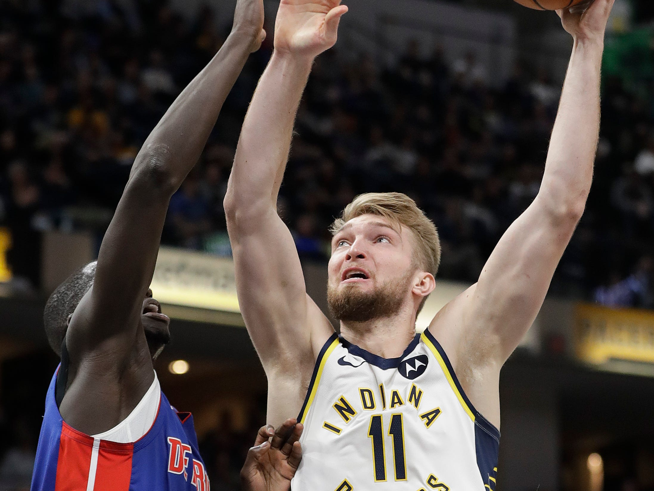 Indiana Pacers' Domantas Sabonis (11) shoots over Detroit Pistons' Thon Maker (7) during the second half.