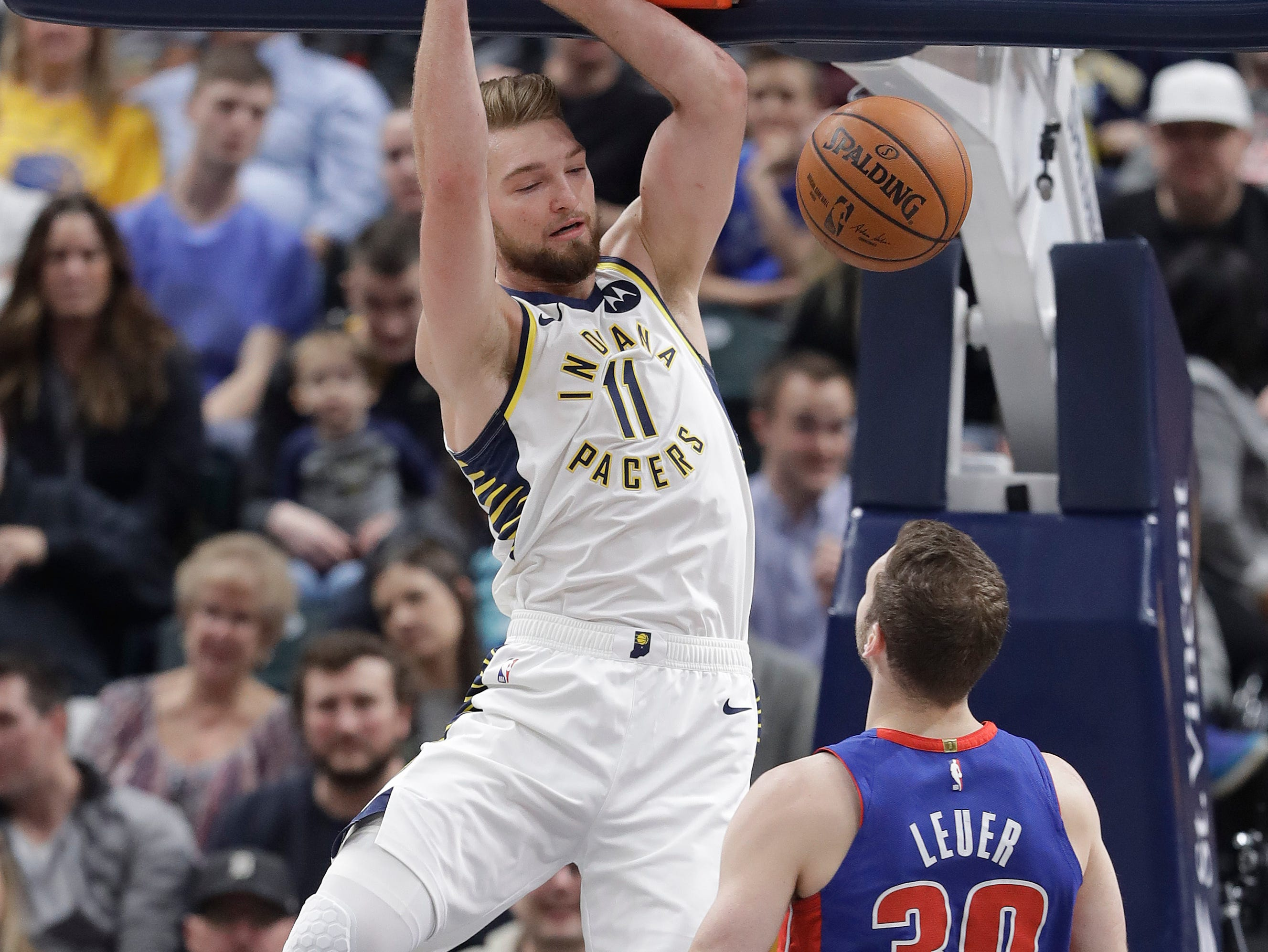 Indiana Pacers' Domantas Sabonis (11) dunks as Detroit Pistons' Jon Leuer (30) watches during the first half.