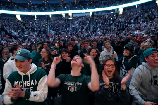 Michigan State fans cheer at a rally early Monday inside the Breslin Center in East Lansing. The Spartans returned from their NCAA men's East Region final, where they defeated Duke, 68-67.