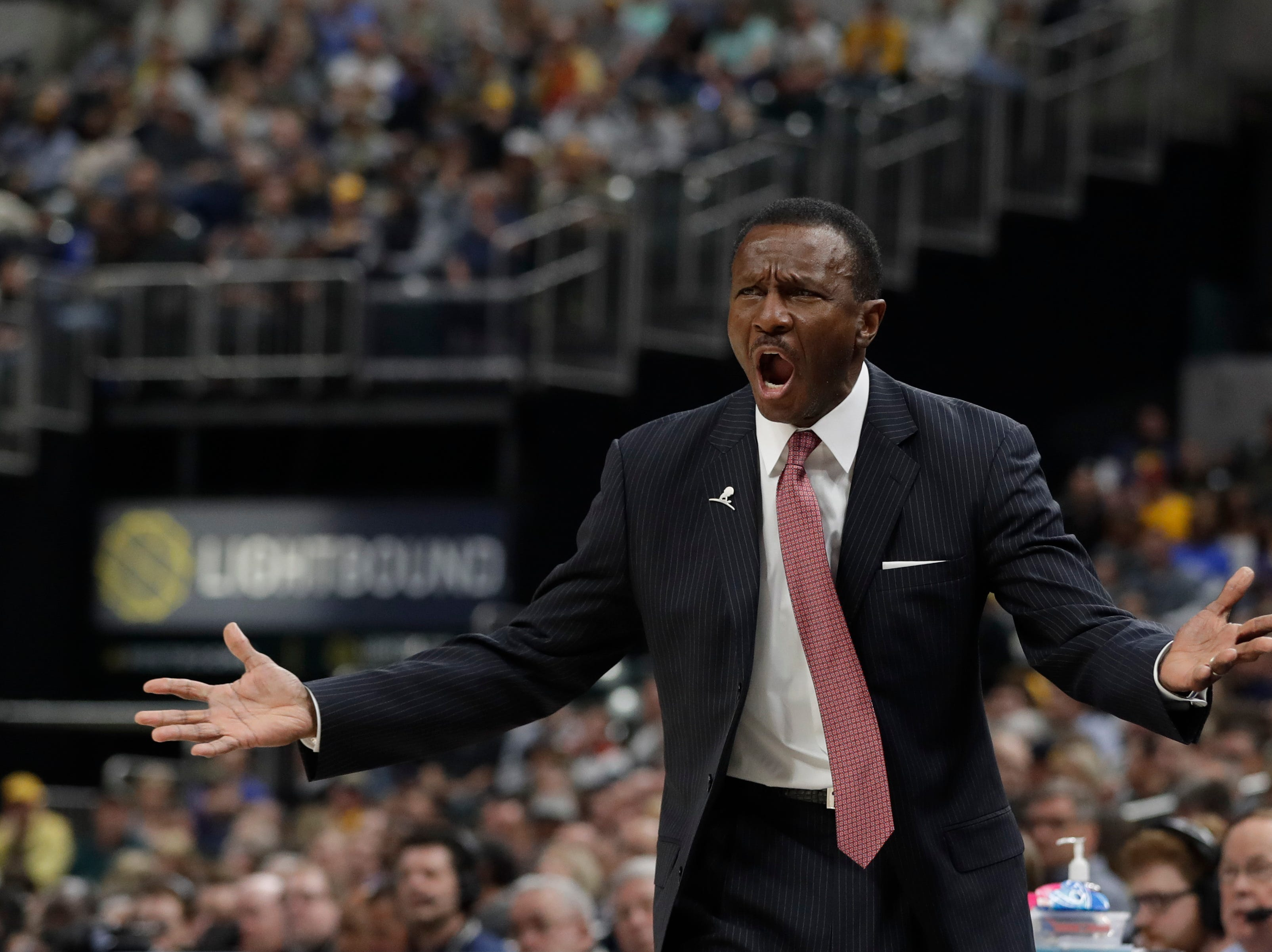 Detroit Pistons head coach Dwane Casey argues a call during the first half.