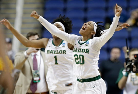 Baylor's Juicy Landrum (20) and NaLyssa Smith (1) celebrate their win over Iowa in a regional final women's college basketball game Monday in the NCAA Tournament in Greensboro, N.C.
