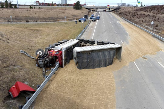 MSP troopers investigate a fatal, gravel-hauler semi rollover accident on M-10 southbound at Telegraph in Southfield, Tuesday, April 2, 2019.